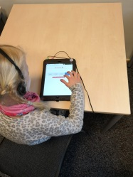 Child playing Dgames on the tablet.